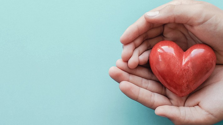 hands holding a heart shaped object